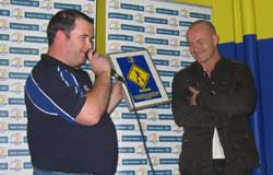 President of the OLSC Robbie O'Connor pictured in the Leinster Supporters Bar presenting Denis Hickie with a gift from the OLSC to mark his retirement